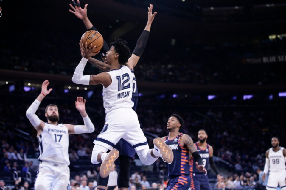 <strong>Memphis Grizzlies' Ja Morant (12) completes one of his eye-popping drives on Jan. 29.</strong> (Frank Franklin II/AP)