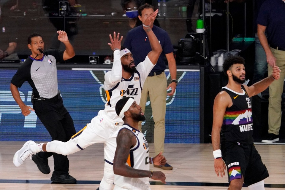 <strong>Utah Jazz's Mike Conley, (middle center); Royce O'Neale (front); Jazz head coach Quin Snyder (center rear), and Denver Nuggets' Jamal Murray watch as Conley's shot rims out in the closing seconds of their NBA first round playoff basketball game, Tuesday, Sept. 1, 2020, in Lake Buena Vista, Fla.</strong> (Mark J. Terrill/AP)