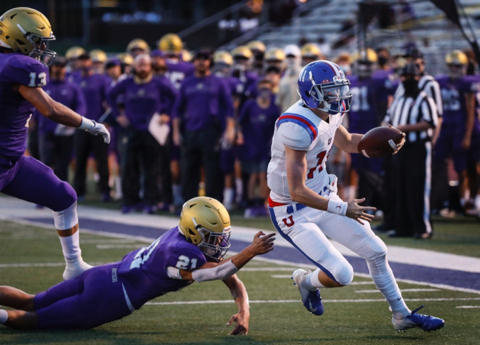 <strong>MUS quarterback Edwin Shy (right) scrambles past CBHS defender Ethan Soefker (left) for a first down during action in their high school football game on Friday, Sept. 4, 2020.</strong> (Mark Weber/Daily Memphian)