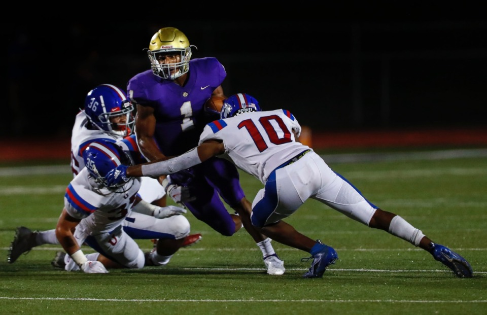 <strong>CBHS running back Dallan Hayden (middle) is tackled by MUS defender Vincent Perkins (right) on Friday, Sept. 4.&nbsp;</strong>(Mark Weber/Daily Memphian)