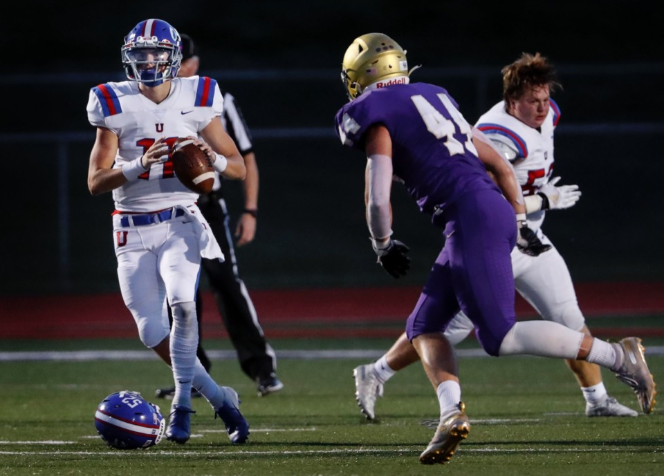 <strong>MUS quarterback Edwin Shy (left) looks fora receiver as CBHS defenders close in on Friday, Sept. 4, 2020. </strong>(Mark Weber/Daily Memphian)