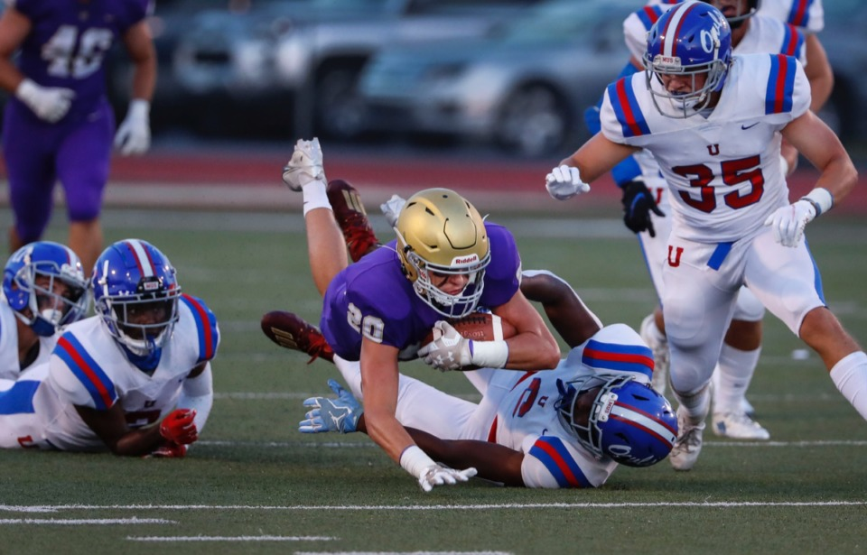 <strong>CBHS receiver Willy Huffman (middle) dives past MUS defender Roderic Lewis (bottom) Friday night.</strong> (Mark Weber/Daily Memphian)