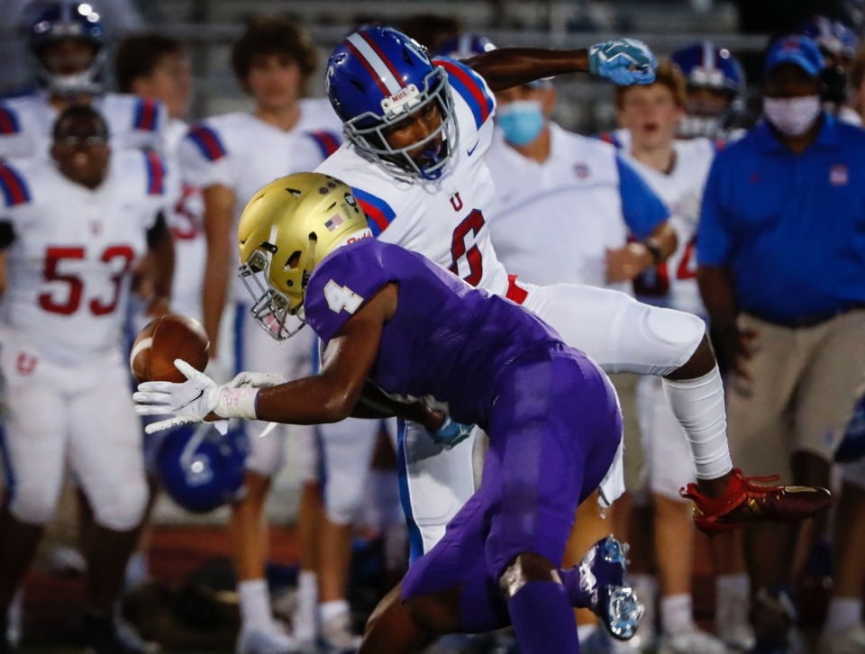 <strong>MUS&rsquo; Roderic Lewis (back) knocks a catch away from CBHS receiver Jaden Davis (front) Friday.&nbsp;</strong>(Mark Weber/Daily Memphian)