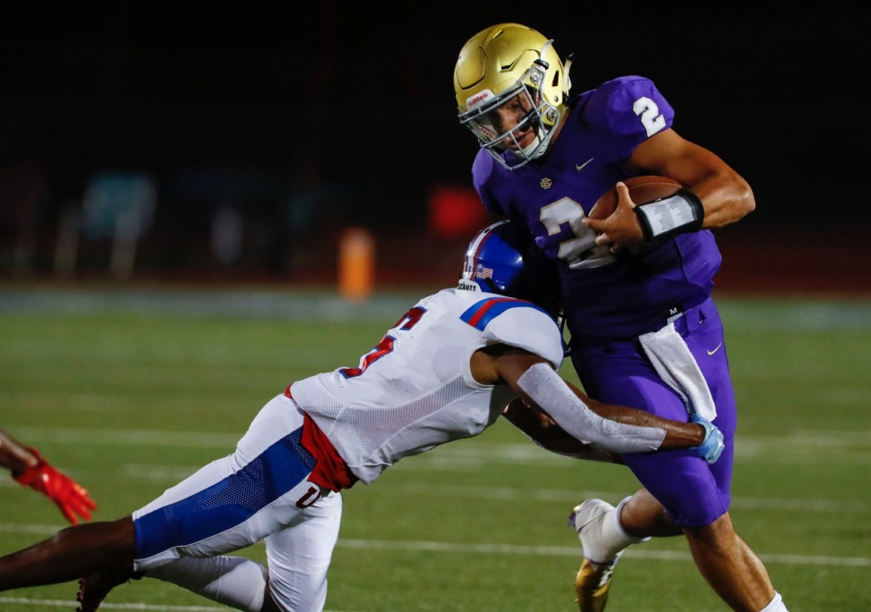 <strong>CBHS quarterback Ashton Strother (right) fights for a first down against MUS defender Roderic Lewis (left) Friday. </strong>(Mark Weber/Daily Memphian)
