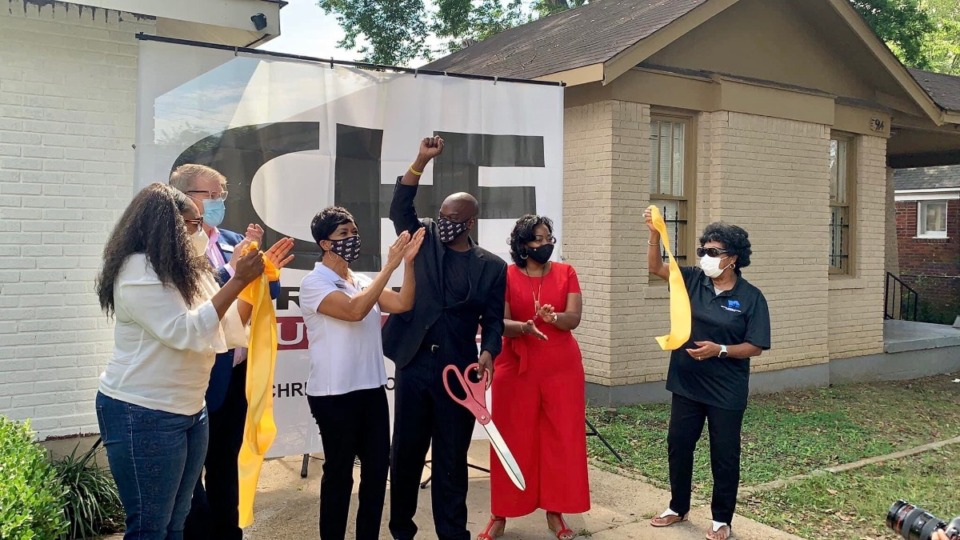 <strong>A team including Chris Hope (holding scissors) and Cheryl Fergerson ofd Quality of Life for All (in red) officially opened the Chris Hope Foundation Family House on Garland Street Saturday, Sept. 5, 2020.</strong> (Submitted)