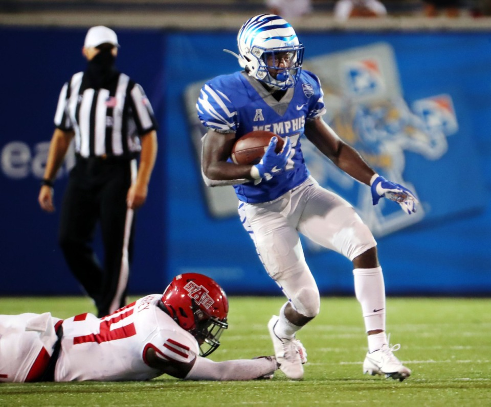<strong>University of Memphis running back Kylan Watkins (17)breaks a tackle from Arkansas State linebacker Fred Harvey(24) on his way to a touchdown during the Tigers' home opener at the Liberty Bowl Sept.5, 2020.</strong> (Patrick Lantrip/Daily Memphian)