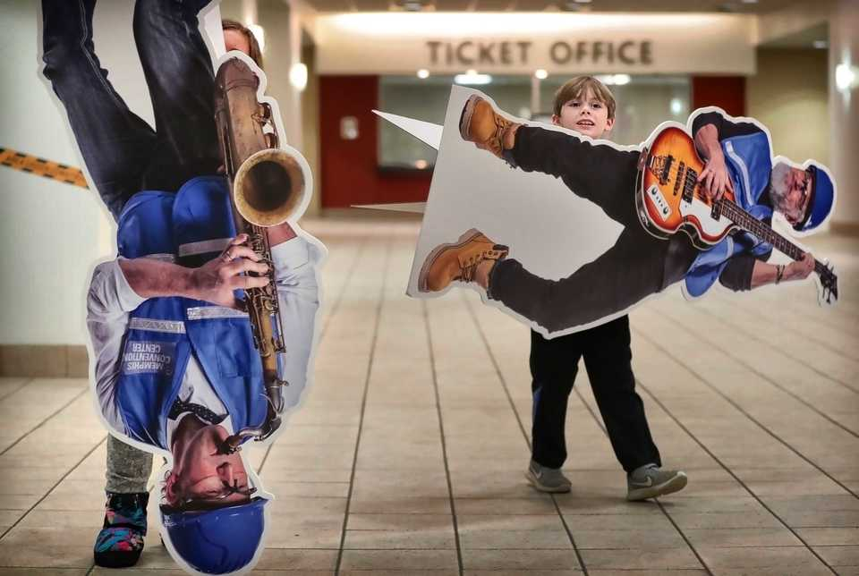 """<strong>Aiden Lebel, 8, and his sister Lexi Lebel, 10, play with some construction worker cutouts at the Memphis Cook Convention Center after a rehearsal for the upcoming """"Nut Remix."""" The cutouts are part of an awareness campaign for the renovation and modernization of the facility.&nbsp;</strong> (Jim Weber/Daily Memphian)"""