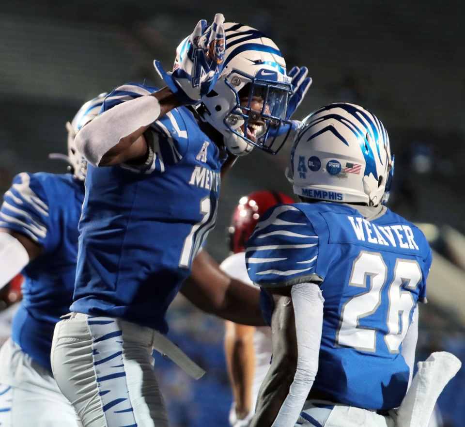 <strong>University of Memphis receiver Damante Coxie (10) celebrates with temmates after scoring a touchdown during the Tigers' home opener against Arkansas State at the Liberty Bowl Sept.5, 2020.</strong> (Patrick Lantrip/Daily Memphian)