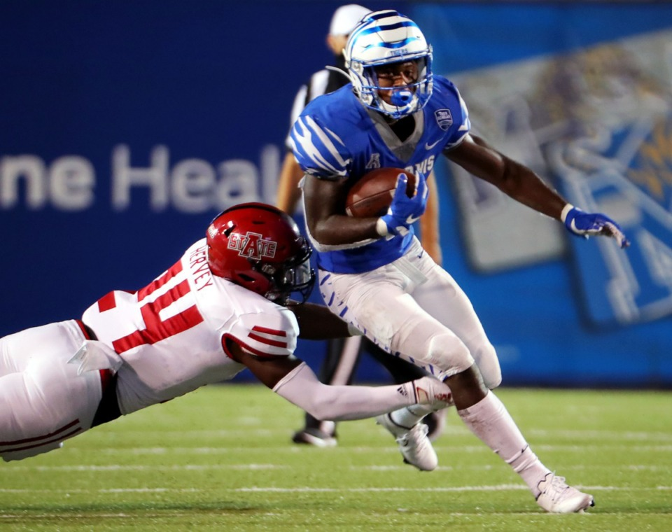 <strong>University of Memphis running back Kylan Watkins (17) breaks a tackle from Arkansas State linebacker Fred Harvey (24) on his way to a touchdown during the Tigers' home opener at the Liberty Bowl Sept.5, 2020.</strong> (Patrick Lantrip/Daily Memphian)