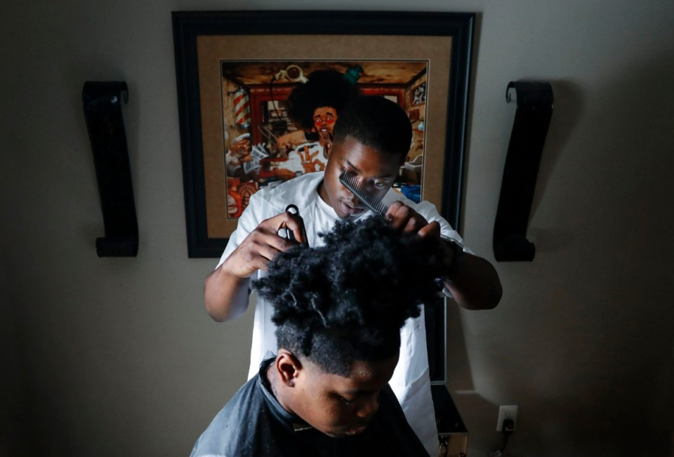 <strong>Youth Villages' LifeSet program participant Mose Frazier gives his younger brother Lamar Frazier a haircut Thursday, Sept. 3, 2020 in their Orange Mound home. The pandemic has made life tougher on the 131 young adults in Youth Villages' LifeSet program that assists the transition into adulthood. </strong>(Mark Weber/Daily Memphian)