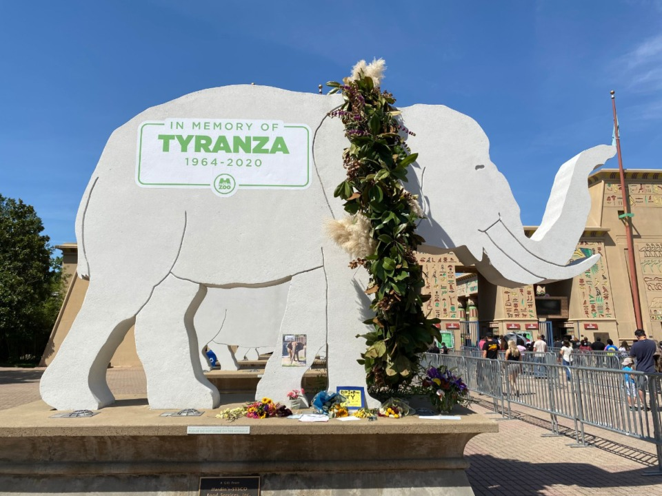 <strong>Visitors are placing cards and floral tributes at the elephant statue at Memphis Zoo in memory of Tyranza.</strong> (Karent Pulfer Focht/Special to Daily Memphian)