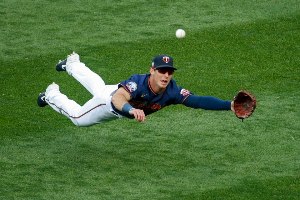 <strong>Minnesota Twins right fielder Brent Rooker (diving for a ball during his major league debut Friday, Sept. 4, 2020, in Minneapolis) grew up in Germantown and attended ECS and later Mississippi State.</strong> (Bruce Kluckhohn/AP)