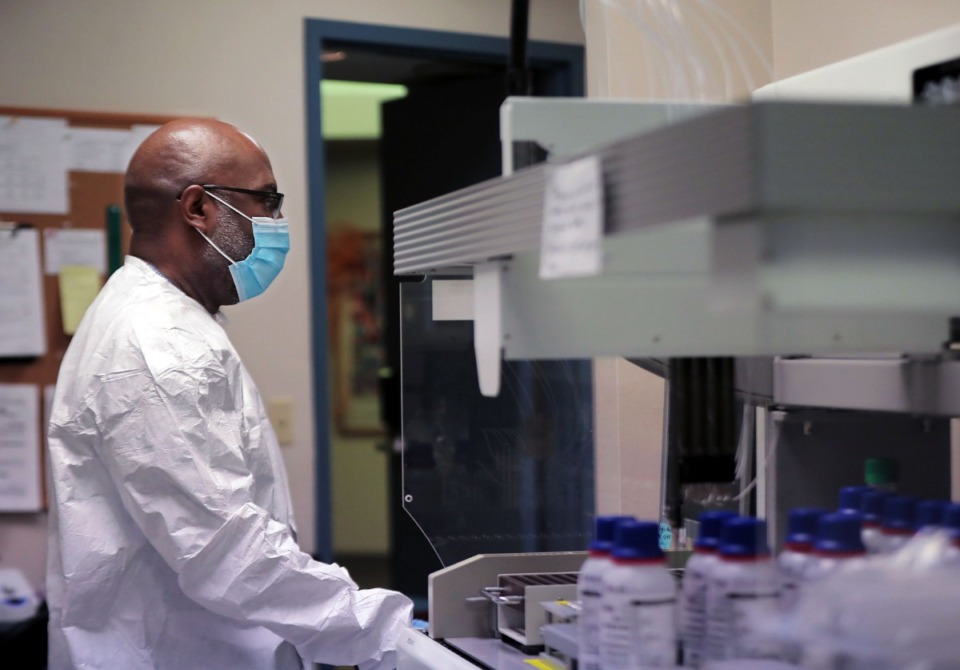 <strong>Paul McQueen tests samples for coronavirus at a University of Tennessee Health Science Center lab Sept. 1, 2020.</strong> (Patrick Lantrip/Daily Memphian)