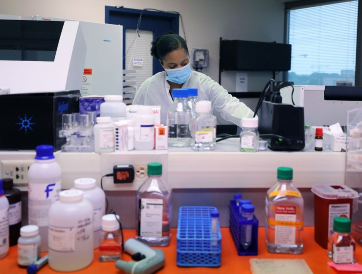 <strong>A University of Tennessee Health Science Center employee works to process coronavirus samples Sept. 1, 2020.</strong> (Patrick Lantrip/Daily Memphian)