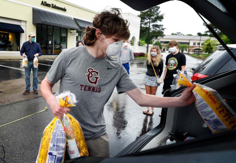 <strong>Earlier this year students from St. George's Independent School&rsquo;s Institute for Citizenship met at The Shops of Saddle Creek to distribute sandwiches for a food mission. The Germantown shopping center has experienced few closures since March.</strong> (Mark Weber/Daily Memphian file)