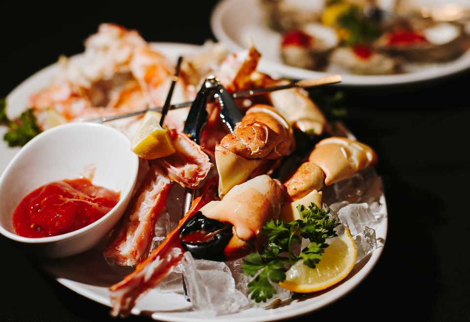 <strong>Alaskan giant red king crab is one of the most popular items on the menu at Ronnie Grisanti's Italian Restaurant in East Memphis. It's served with cocktail sauce that has been frozen with liquid nitrogen &ndash; part of owner Judd Grisanti's vision of preparing old recipes in new ways.</strong> (Houston Cofield/Daily Memphian)