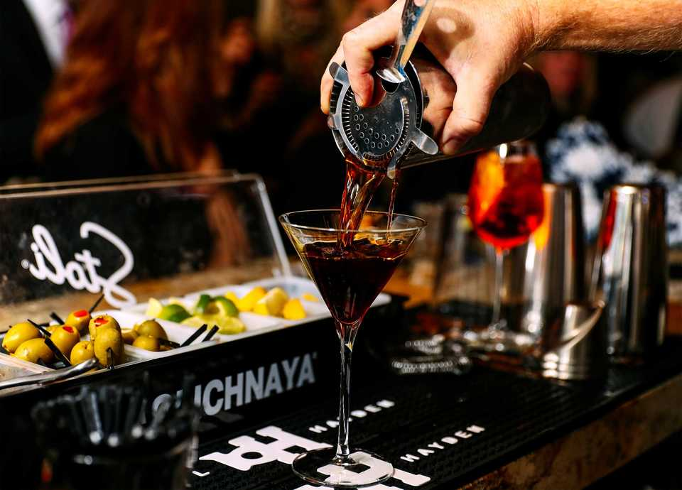 <strong>Ronnie Grisanti's bartender Chris Backey pours a Black Manhattan, a specialty cocktail featuring Averna amaro instead of vermouth.</strong> (Houston Cofield/Daily Memphian)