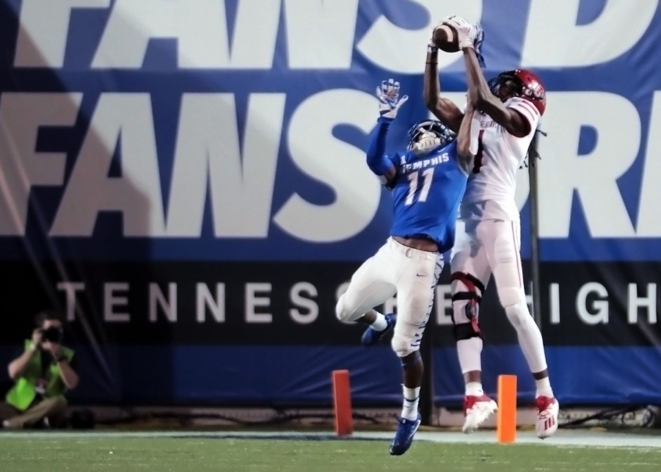 <strong>Cornerback Sylvonta Oliver (11, going up for an interception) is one of the University of Memphis reserves thrust into heavy playing time during the Tigers' home opener against Arkansas State at the Liberty Bowl Sept. 5, 2020.</strong> (Patrick Lantrip/Daily Memphian)