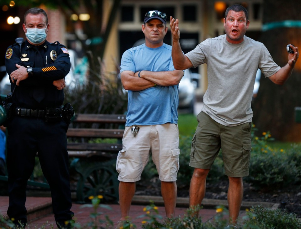 <strong>Bystanders speak to protesters during a sit-in at Town Square Park on Monday, Sept. 7, 2020 in Collierville.</strong> (Mark Weber/The Daily Memphian)