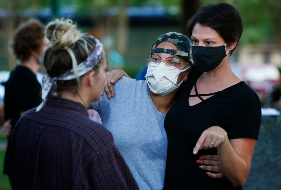 <strong>Activist LJ Abraham (middle) hugs Emily Fulmer (right) while they speak to a bystander during a sit-in at Town Square Park on Monday, Sept. 7, 2020 in Collierville.</strong> (Mark Weber/The Daily Memphian)