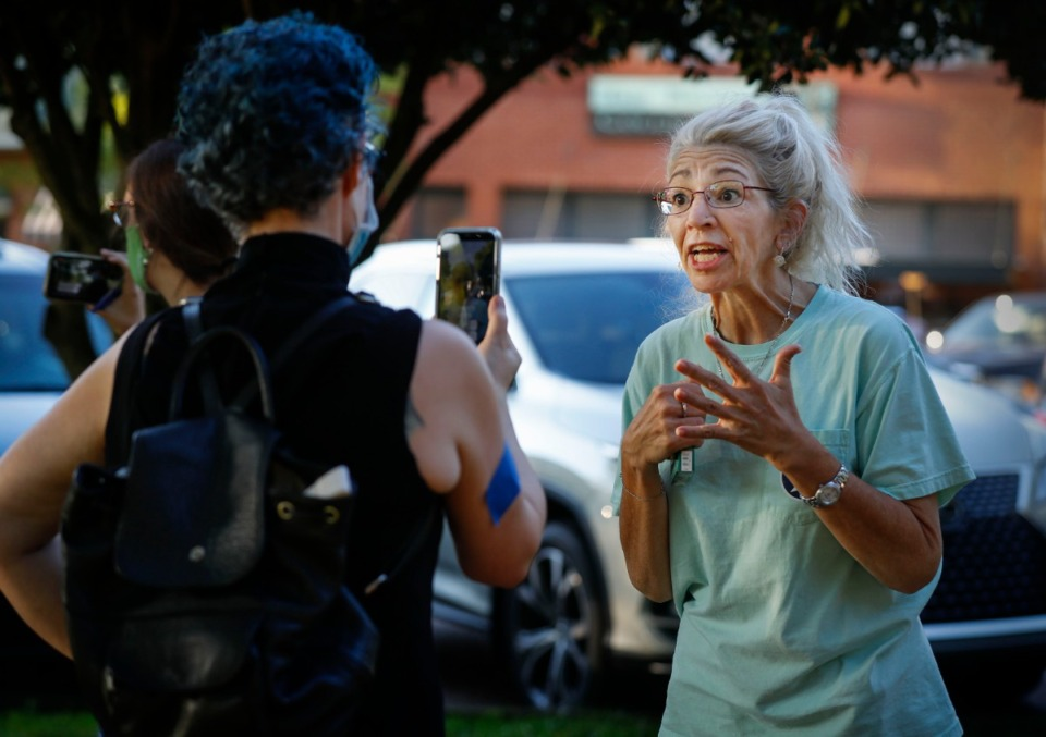 <strong>Collierville resident Theresa Turney (right) speaks to Rev. Edith Love during a sit-in at Town Square Park on Monday, Sept. 7, 2020 in Collierville.</strong> (Mark Weber/The Daily Memphian)