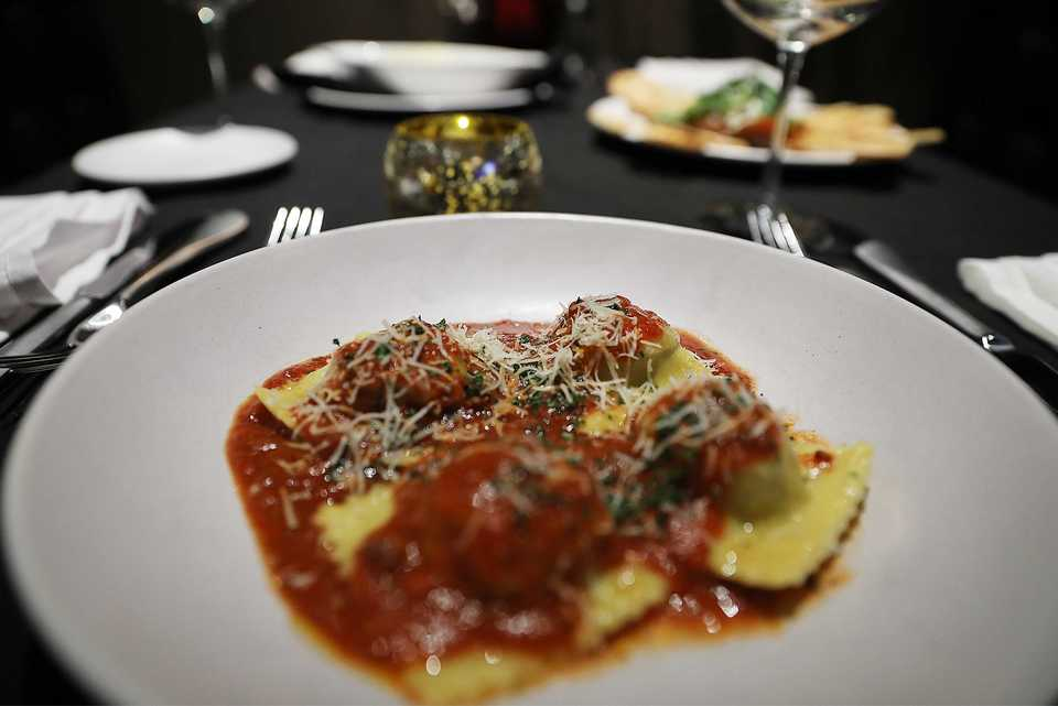 <strong>Handmade ravioli is stuffed with Grisanti's Italian sausage, beef, spinach and cheese, served with cheese and Tuscan gravy on top.</strong> (Patrick Lantrip/Daily Memphian)