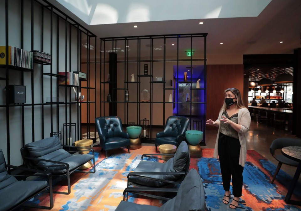 <strong>Jessica Billings, director of sales and marketing, gives a tour of Canopy's lobby Sept. 8, 2020.</strong> (Patrick Lantrip/Daily Memphian)