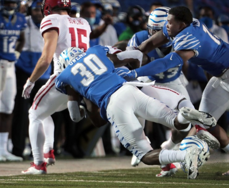 University of Memphis defensive back Rodney Owens (30) drags down an Arkansas State player during the Tigers' home opener at the Liberty Bowl Sept. 5, 2020. (Patrick Lantrip/Daily Memphian)