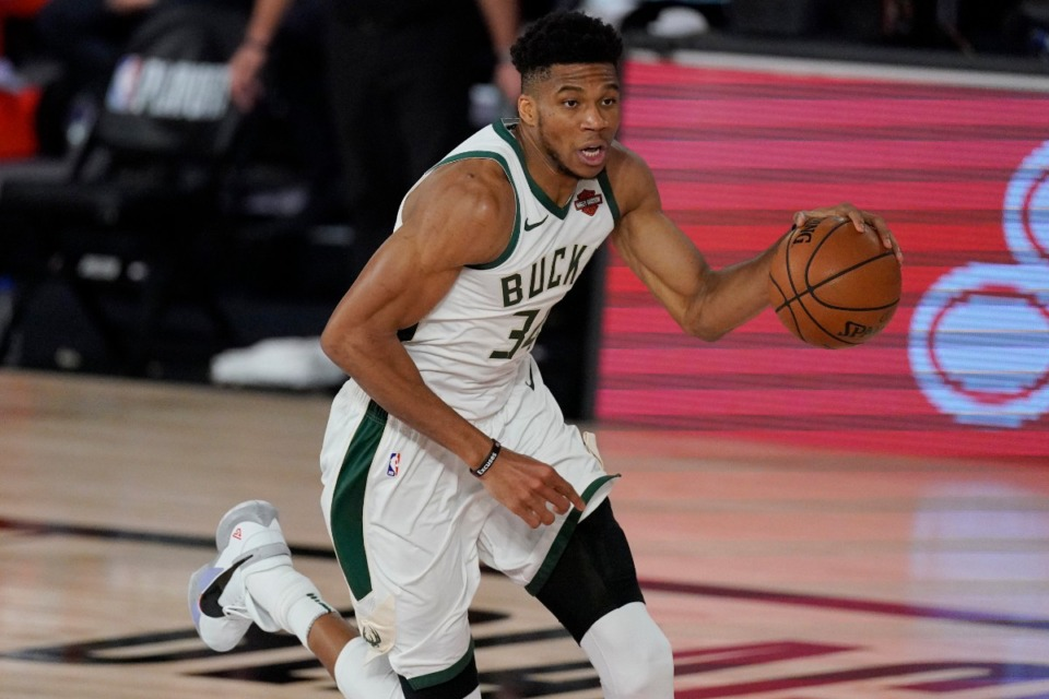 <strong>Milwaukee Bucks' Giannis Antetokounmpo (34) in the second half of an NBA conference semifinal playoff basketball game against the Miami Heat Friday, Sept. 4, 2020, in Lake Buena Vista, Fla.</strong> (AP Photo/Mark J. Terrill)