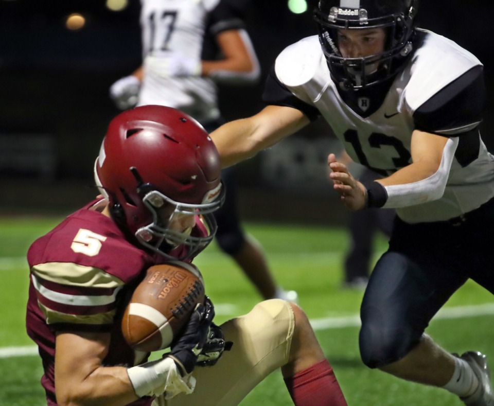 <strong>Evangelical Christian School junior Caiden Hill (5) hauls in the ball during home game against Houston High School Sept. 11, 2020.</strong> (Patrick Lantrip/Daily Memphian)