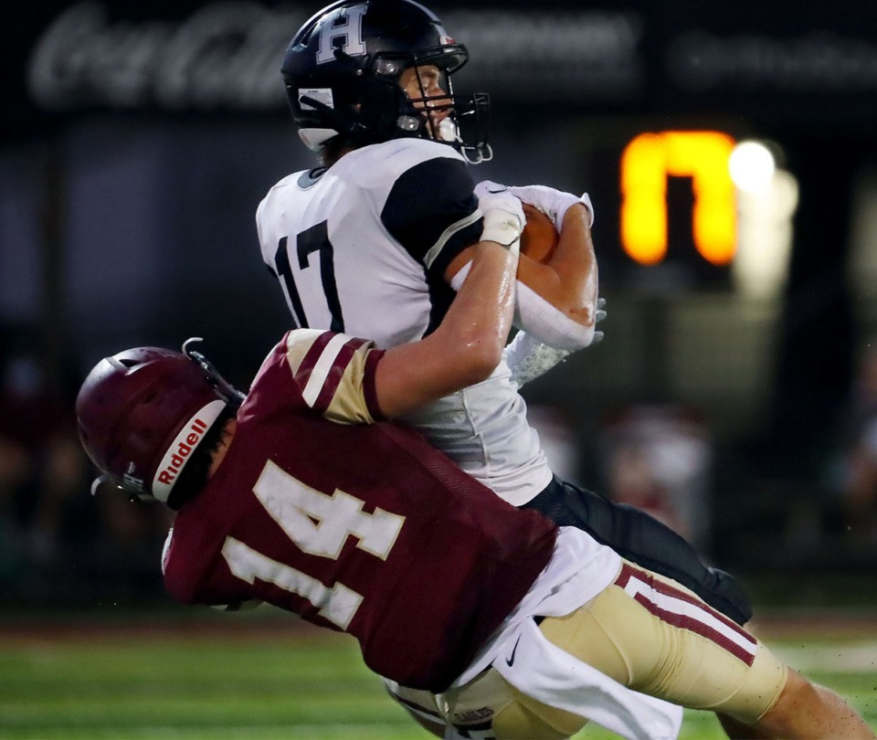 <strong>Houston High School receiver Carson Goold (17) goes up for a first down catch during a Sept. 11, 2020 game at Evangelical Christian School.</strong> (Patrick Lantrip/Daily Memphian)