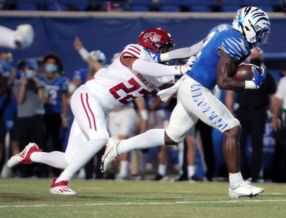 <strong>University of Memphis running back Rodrigues Clark (2) breaks a tackle from Arkansas State linebacker Caleb Bonner (22) on his way to a touchdown during the Tigers' home opener at the Liberty Bowl Sept.5, 2020.</strong> (Patrick Lantrip/Daily Memphian)