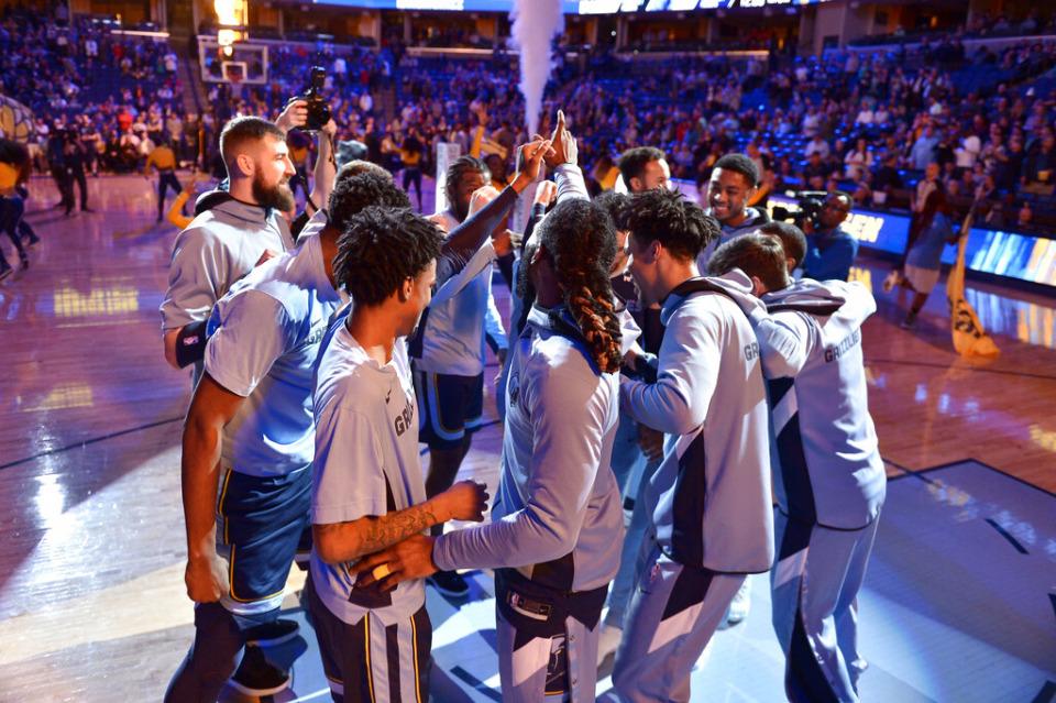 Memphis Grizzlies players huddle before an NBA basketball game against the San Antonio Spurs Friday, Jan. 10, 2020, in Memphis, Tenn. (AP Photo/Brandon Dill)