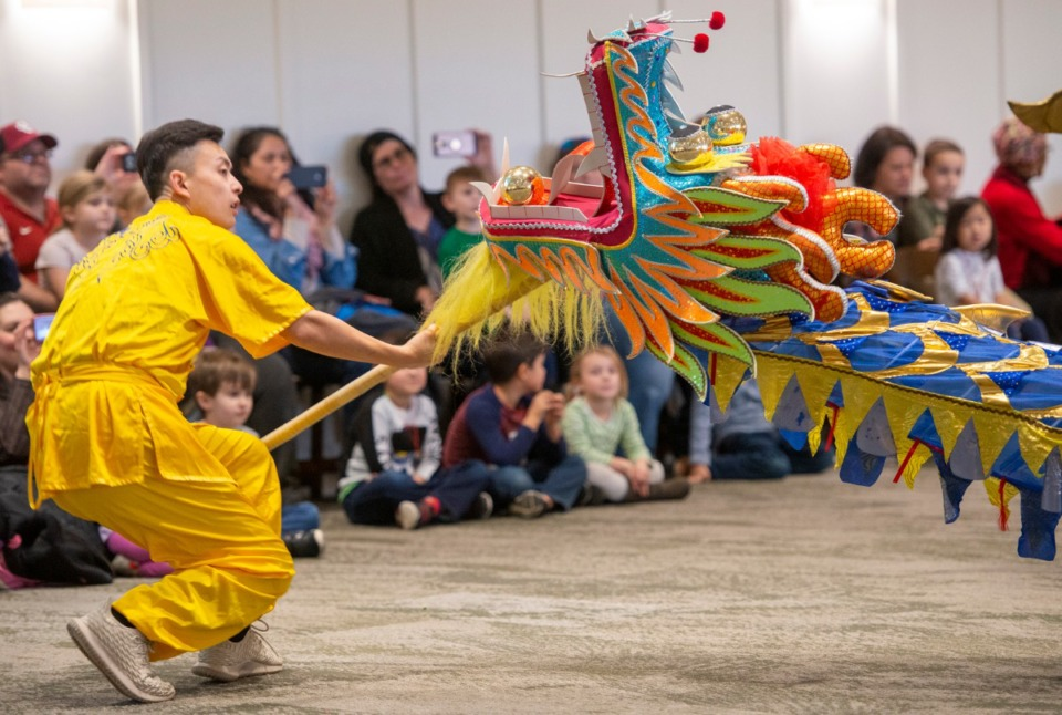 <strong>Renhao Duan leads the tradtional dragon dance at the Chinese New Year celebration at the Children's Museum of Memphis Saturday, February 8, 2020. Duan is a member of the Confucius Institute at the University of Memphis.</strong> (Greg Campbell/Special for The Daily Memphian file)