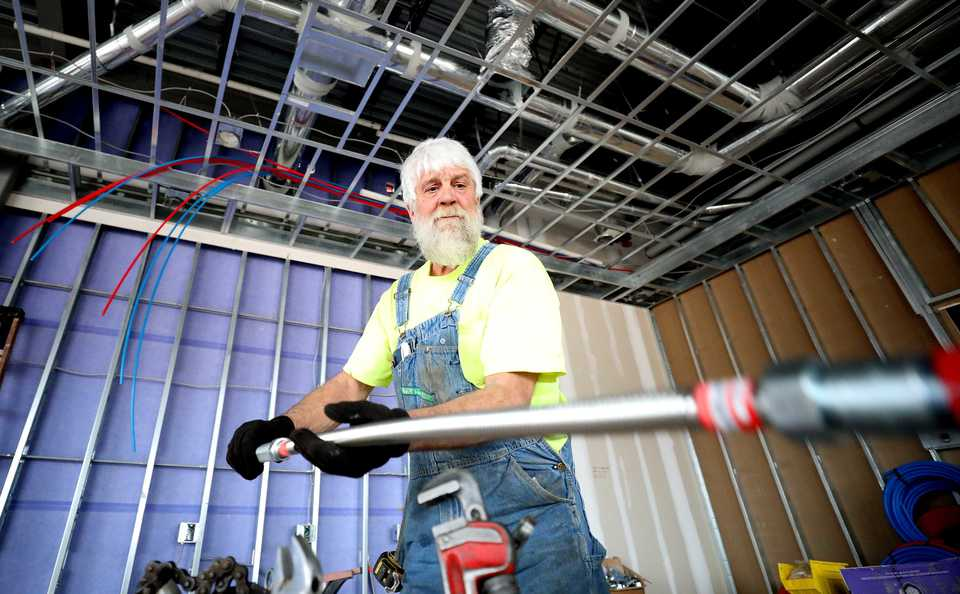 <strong>Joe Pennington, an employee for Action Fire Protection, installs a fire sprinkler system into a nail salon that will be one of the retailers in the new Houston Levee Market development in Collierville. The 11,312-square-foot development will also include a couple of new restaurants.</strong> (Houston Cofield/Daily Memphian)