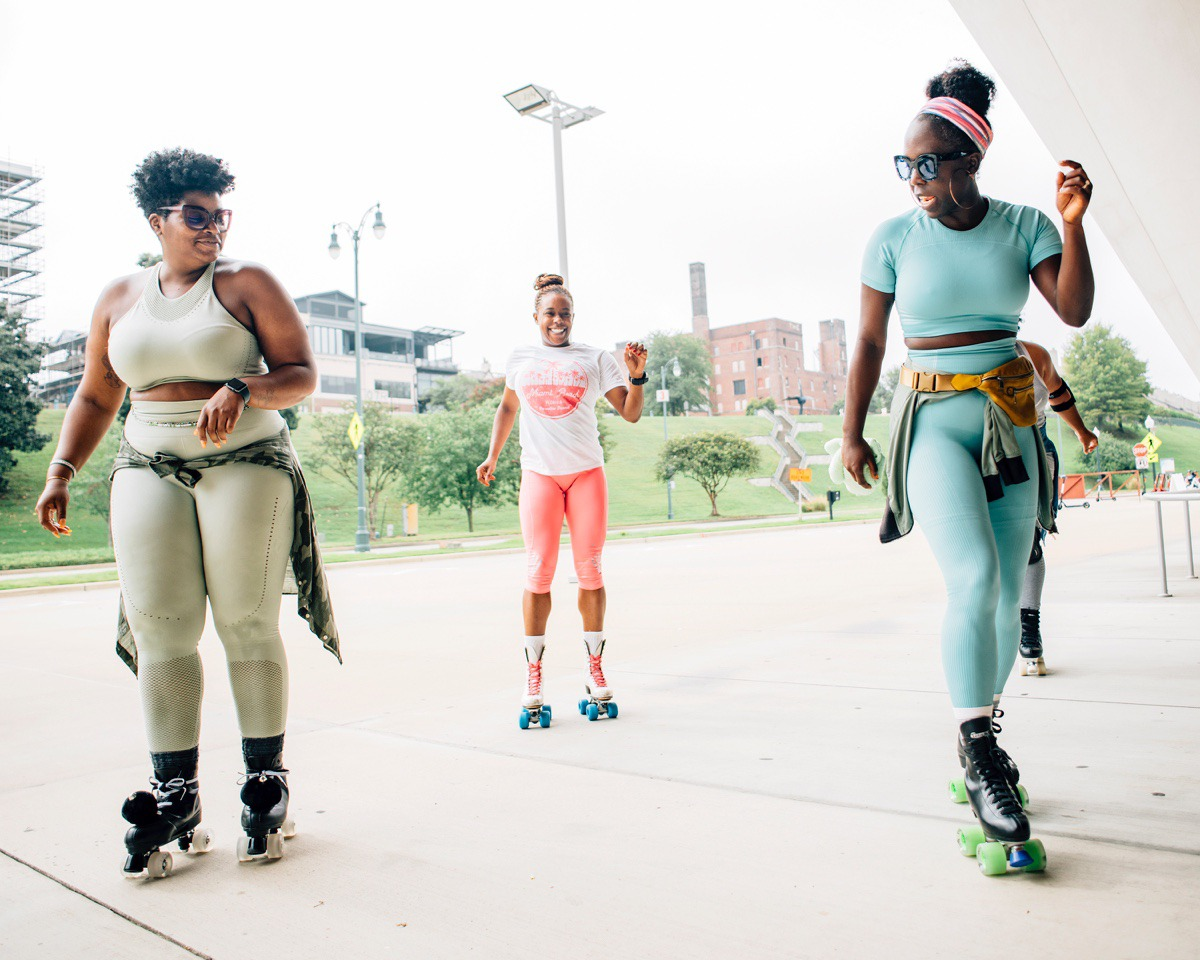 <strong>Ali Manning (right) teaches Shambrika Randle (left) some dance moves in front of Beale Streat Landiing. Manning grew up ice skating and has now recruited about 15 women to join her twice a week to skate</strong>. (Houston Cofield/Special To The Daily Memphian)
