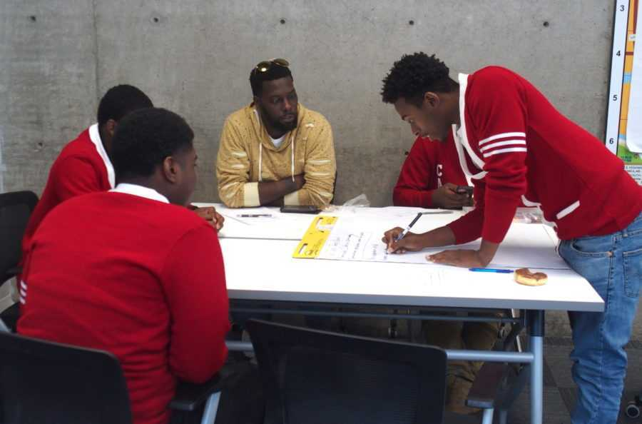 """<div class=""""featured-image article-img""""> <div class=""""img-wrapper""""> <div class=""""img-credit""""> <div class=""""credit""""><strong>Memphis alternative school students work with local activist Keedran Franklin, in yellow, to brainstorm policy proposals to prevent other youth from being incarcerated. At the top of the list were mentoring and jobs. Just below that was a call to eliminate suspensions and expulsions and replace them with fostering better relationships between teachers and students.</strong> (<span>Laura Faith Kebede/Chalkbeat)</span></div> </div> </div> </div>"""