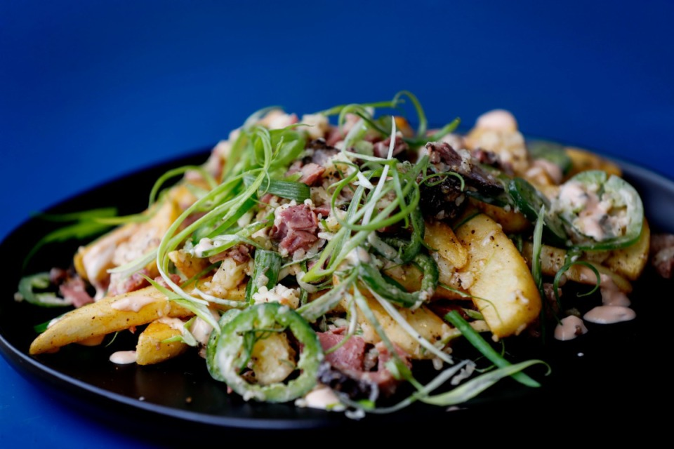 <strong>Hazel's Lucky Dice Delicatessen&rsquo;s oy vey Fries features fat fries with pastrami, Russian dressing, jalape&ntilde;os, cheese and scallions.</strong> (Mark Weber/The Daily Memphian)