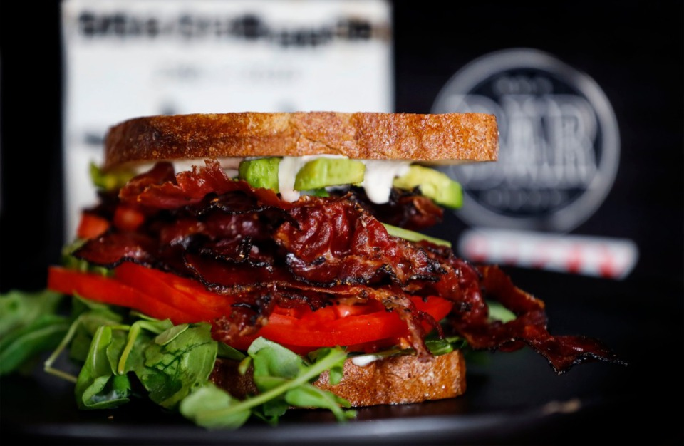 <strong>Hazel's Lucky Dice Delicatessen&rsquo;s PLTA sandwich features crispy pastrami bacon, lettuce, tomato, avocado, horseradish mayonnaise, Jewish rye, served with a pickle and chips.</strong> (Mark Weber/The Daily Memphian)