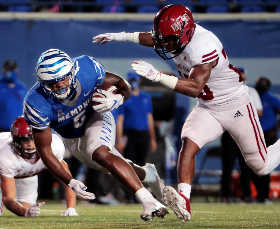 <strong>University of Memphis tight end Sean Dykes (5) dodges an Arkansas State defender in the Sept. 5, 2020, game that Memphis won 37-24.</strong> (Patrick Lantrip/Daily Memphian)
