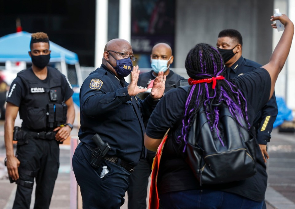 <strong>Memphis Police Deputy Chief Micheal Hardy (middle) talks to a protester outside City Hall on Wednesday, July 1, 2020.</strong> (Mark Weber/Daily Memphian)