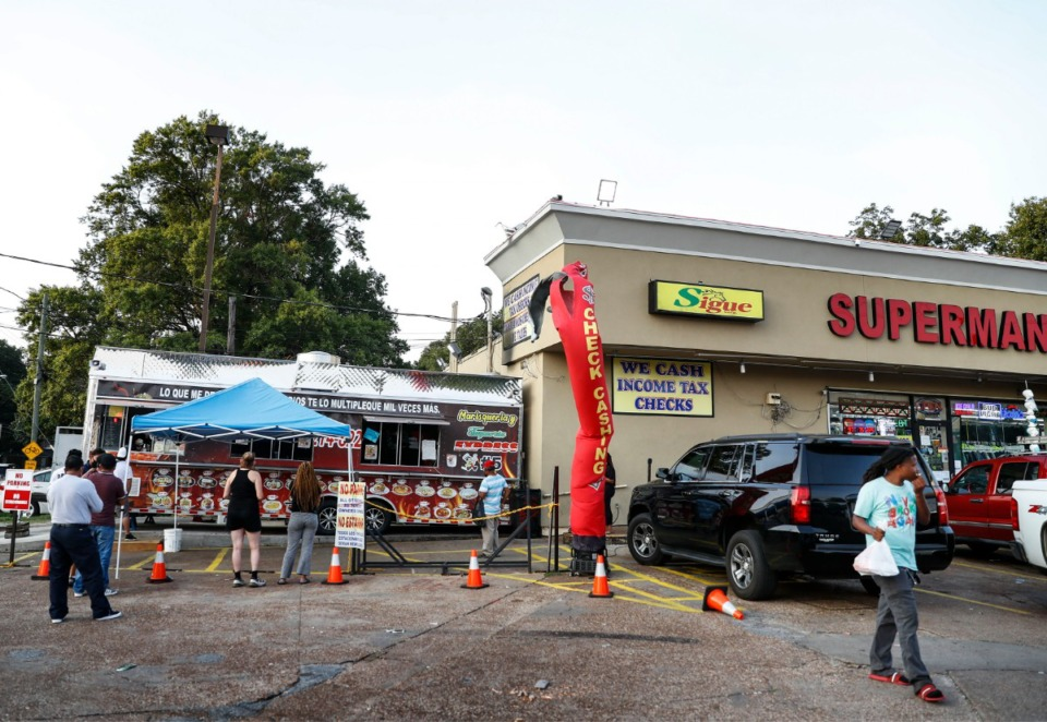 <strong>A line of customers gather outside the Taqueria Express #5 Mexican food truck on Tuesday, Sept. 8, 2020 in the Superman convenient store parking lot on Summer Ave.</strong> (Mark Weber/The Daily Memphian)