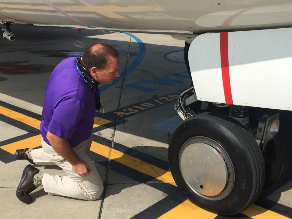 <strong>Victor Gasior of FedEx Express inspects WheelTug up close on Tuesday, Sept. 15, at Memphis International Airport.</strong> (Wayne Risher/Daily Memphian)