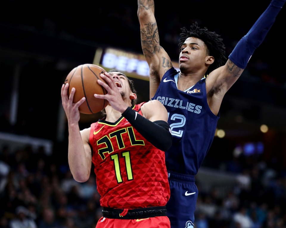 <strong>Memphis Grizzlies guard Ja Morant (12) plays tight defense on Atlanta Hawks guard Trae Young (11) during a March 7, 2020 game at the FedExForum against the Atlanta Hawks.</strong> (Patrick Lantrip/Daily Memphian file)