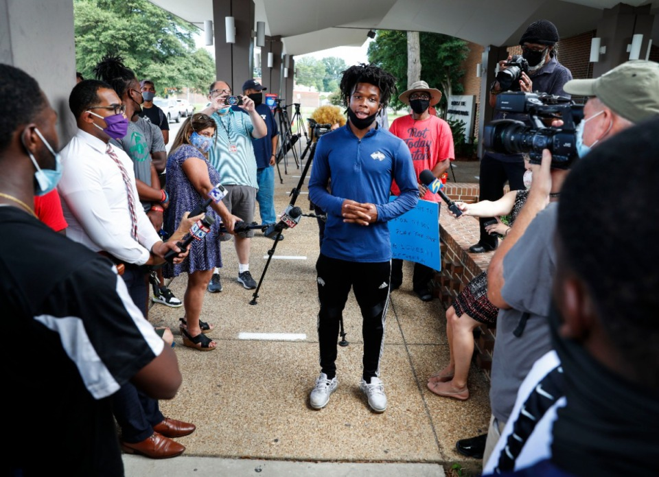 <strong>Kirby High School senior Kaleb Almo (middle) speaks to student athletes and parents outside Shelby County Schools Board of Education building on Wednesday, Sept. 16, as they protest the district&rsquo;s decision to cancel fall sports.</strong> (Mark Weber/Daily Memphian)
