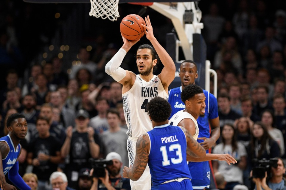 <strong>Georgetown center Omer Yurtseven (44) looks to pass against Seton Hall guard Myles Powell (13) during the first half of an NCAA college basketball game, Wednesday, Feb. 5, 2020, in Washington.</strong> (Nick Wass/AP)