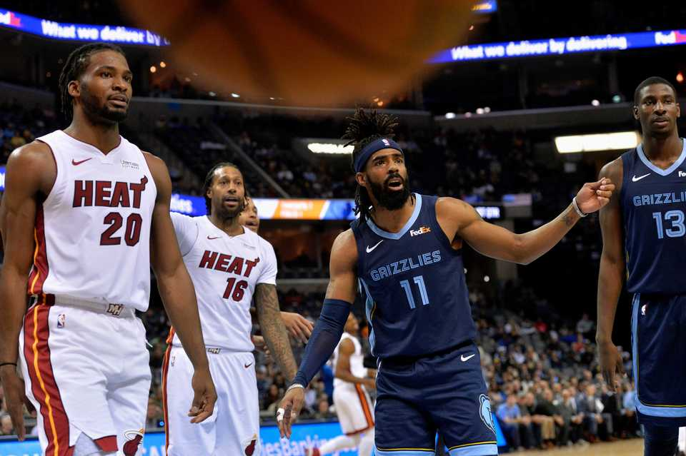 <span><strong>Miami Heat forwards Justise Winslow (20) and James Johnson (16), and Memphis Grizzlies guard Mike Conley (11) and forward Jaren Jackson Jr. (13) look to a referee for a ruling as the ball bounces out of bounds in the first half of an NBA basketball game Friday, Dec. 14, at FedExForum.</strong> (AP Photo/Brandon Dill)</span>
