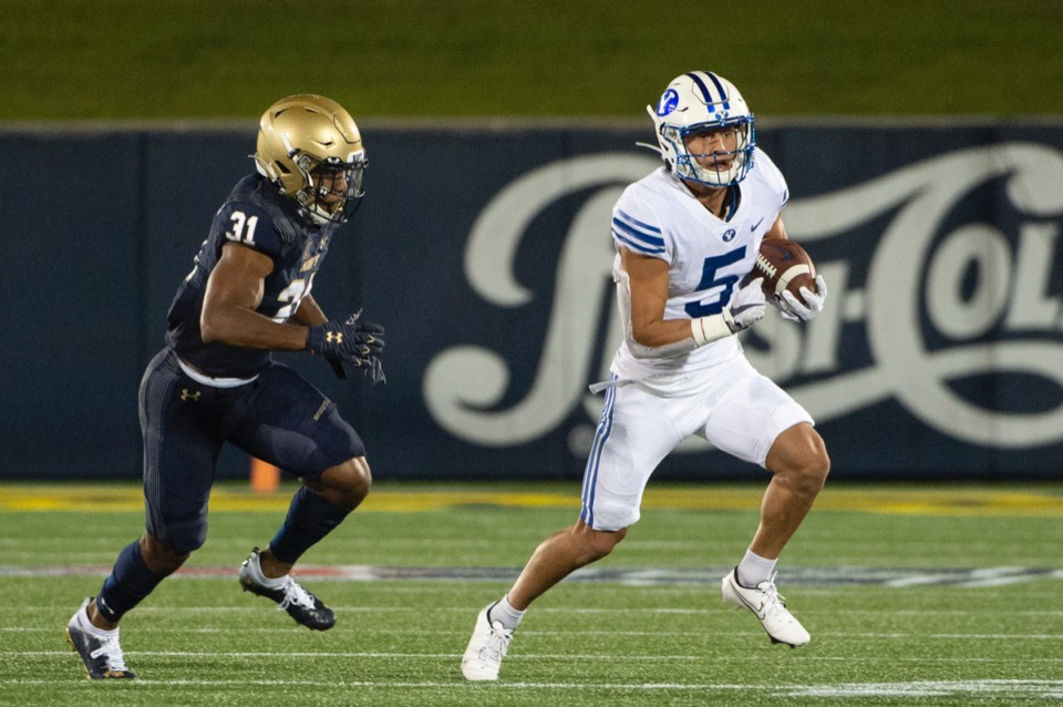 <strong>BYU's Dax Milne (5) runs after making a reception as Navy linebacker Austin Talbert-Loving (31) chases on Sept. 7. The Midshipmen lost this game badly, 55-3, but maybe they&rsquo;ll have better luck this weekend against Tulane.</strong> (Tommy Gilligan/AP file)