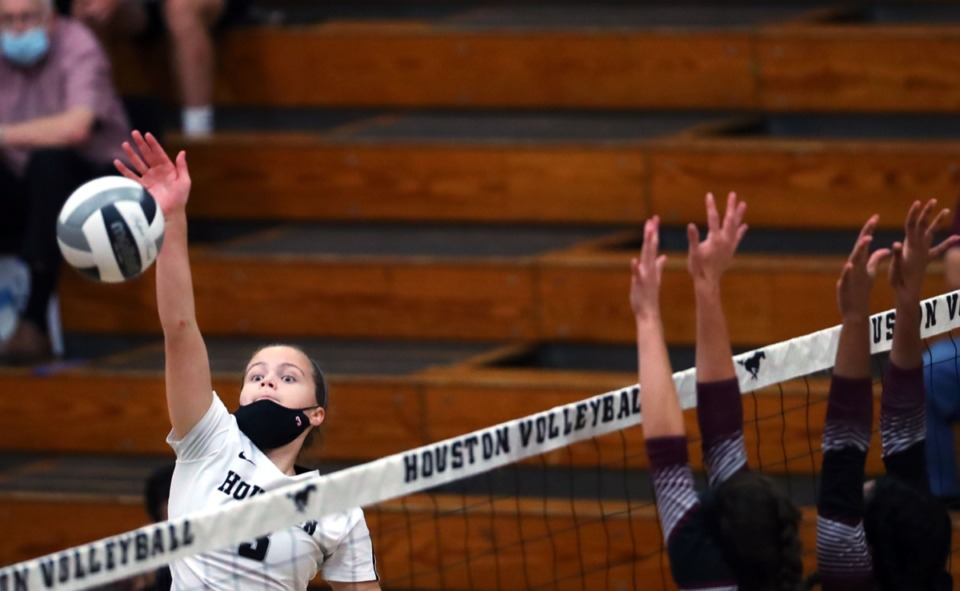 <strong>Houston junior Rachel Stamey spikes the ball during the Sept. 17 game against Collierville.</strong> (Patrick Lantrip/Daily Memphian)