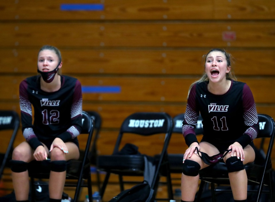 <strong>Collierville players Mary Stubbs (11) and Abbi Peterson (12) cheer on their teammates Sept. 17 at Houston High School.</strong> (Patrick Lantrip/Daily Memphian)